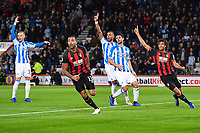 Callum Wilson of AFC Bournemouth scores the first goal and celebrates as Huddersfield Town players appeal during AFC Bournemouth vs Huddersfield Town, Premier League Football at the Vitality Stadium on 4th December 2018