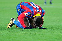 Wilfried Zaha of Crystal Palace on his knees  during the Premier League match between Crystal Palace and Watford at Selhurst Park, London, England on 12 December 2017. Photo by Carlton Myrie / PRiME Media Images.