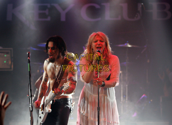 DAVE NAVARRO & COURTNEY LOVE.Perform at The Camp Freddy South East Asia Tsunami Relief Fund Benefit held at The Key Club in West Hollywood, California .January 27th, 2005.half length, stage, gig, concert, white dress, singing, guitar.www.capitalpictures.com.sales@capitalpictures.com.Supplied By Capital PIctures