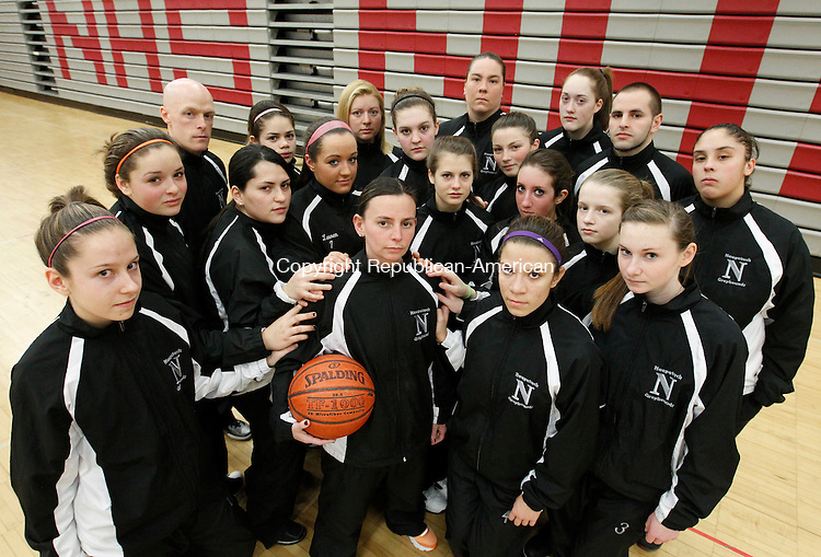 Naugatuck, CT-24 February 2012-022412CM01-  Naugatuck girls basketball head coach, Jodie Ruccio (center with ball) is surrounded by her coaches and team during a practice Friday afternoon at Naugatuck High School.   Ruccio who recently lost her husband, had tremendous support from her team and coaching staff.    Christopher Massa Republican-American