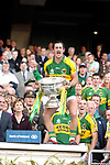KERRY V CORK ALLIRELAND FINAL 17-9-07<br />Paul Galvin shows his acrobatic skills by standing on the trophy shelf to lift the Sam Maguire cup higher than anybody else much to the surprise of officials and President mcAlleese after the All-Ireland Final on Sunday.<br />Picture by Don MacMonagle