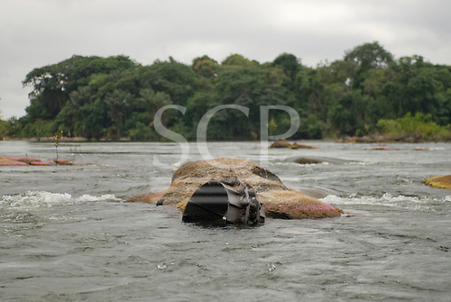 Pará State, Brazil. Xingu River. Rapids with abandoned mining equipment.