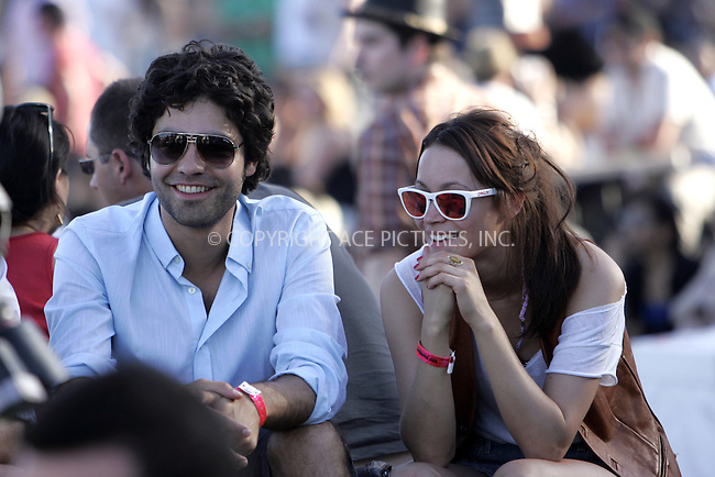 WWW.ACEPIXS.COM . . . . . ....April 19 2009, CA....Actor Adrian Grenier and friend at the 2009 Coachella Valley Music & Arts Festival April 19, 2009 in Indio, California.....Please byline: JOE WEST- ACEPIXS.COM.. . . . . . ..Ace Pictures, Inc:  ..(646) 769 0430..e-mail: info@acepixs.com..web: http://www.acepixs.com