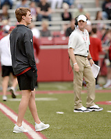 NWA Democrat-Gazette/ANDY SHUPE<br /> Chandler Morris (left), son of Arkansas coach Chad Morris (right), watches Saturday, April 6, 2019, during the Razorbacks' spring game in Razorback Stadium in Fayetteville. Visit nwadg.com/photos to see more photographs from the game.