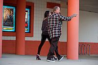 Aug. 29, 2013; Avon, IN, USA: NHRA funny car driver Alexis DeJoria (left) and husband Jesse James following the premiere of Snake & Mongoo$e at the Regal Shiloh Crossing Stadium 18. Mandatory Credit: Mark J. Rebilas-