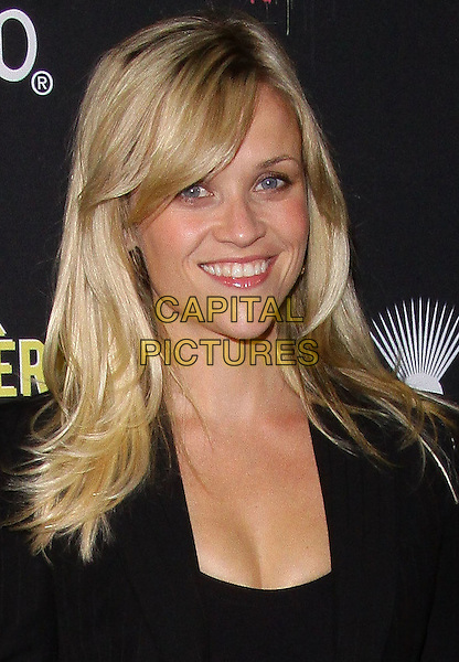 "REESE WITHERSPOON.Art Mére Art Pére for Livestrong Event ""held at The Smashbox Studios, Hollywood, California, USA,.23rd September 2010..portrait headshot black fringe smiling .CAP/ADM/TC.©T. Conrad/AdMedia/Capital Pictures."