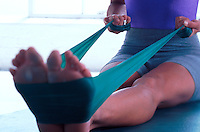 lose up of a physical therapy band in use during a workout.