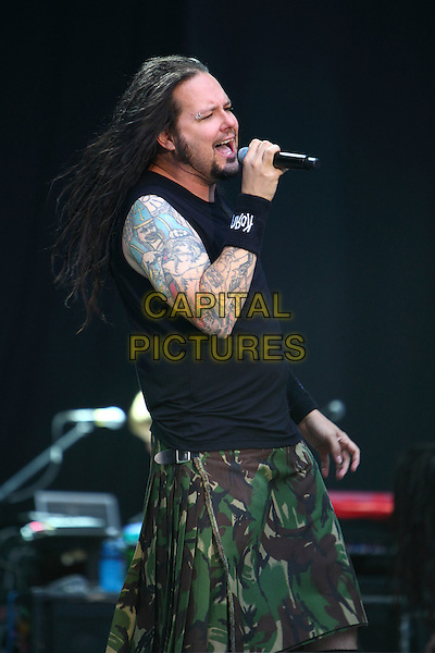 Korn.Concert in Moscow, Russia..July 8th, 2009.on stage in concert live gig performance performing music half length black sleeveless top tattoos green camouflage skirt singing profile side.CAP/PER/SB.© SB/Persona/CapitalPictures