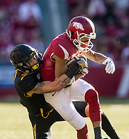 Hawgs Illustrated/BEN GOFF <br /> Cam Hilton, Missouri free safety, tackles Deon Stewart, Arkansas wide receiver, after a catch in the second quarter Friday, Nov. 24, 2017, at Reynolds Razorback Stadium in Fayetteville.