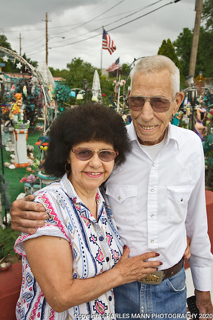 """C. L. """"Tunnie"""" Sharpe and his wife Helen in front of the quirky and colorful folk art garden they have spent years making at their home in Santa Fe, New Mexico."""