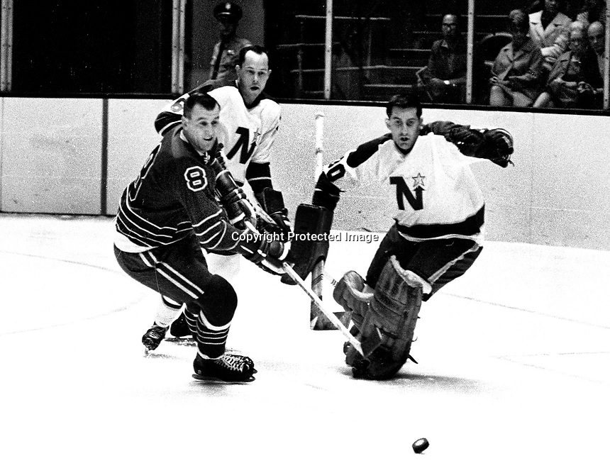 Seals Gerry Ehman ..Northstars goalie Cesare Maniago, (1967 photo/Ron Riesterer)