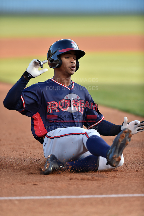 Rome Braves right fielder Ray-Patrick Didder (11) slides into third during a game against the Rome Braves at McCormick Field on April 14, 2016 in Asheville, North Carolina. The Braves defeated the Tourists 4-3. (Tony Farlow/Four Seam Images)