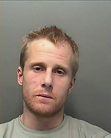 "Pictured: Undated police handout custody picture of Dean Marcus Jones <br /> Re: A Swansea heroin addict has been jailed for 13-and-a-half-years over the death of his girlfriend.<br /> Dean Marcus Jones, 38, pleaded guilty to manslaughter on the first day of his trial at Swansea Crown Court for killing Alison Farr-Davies, 42.<br /> Sentencing, Judge Keith Thomas said her death involved ""a wholly unprovoked and senseless attack"" in September 2016.<br /> The court had heard the pair's relationship ""involved class A drug use"".<br /> Jones admitted not seeking medical help soon enough for Miss Farr-Davies after she fell down the stairs of their flat and suffered a serious head injury.<br /> A pathologist also described other injuries such as broken ribs, bite marks and blunt trauma to her face consistent with an assault."