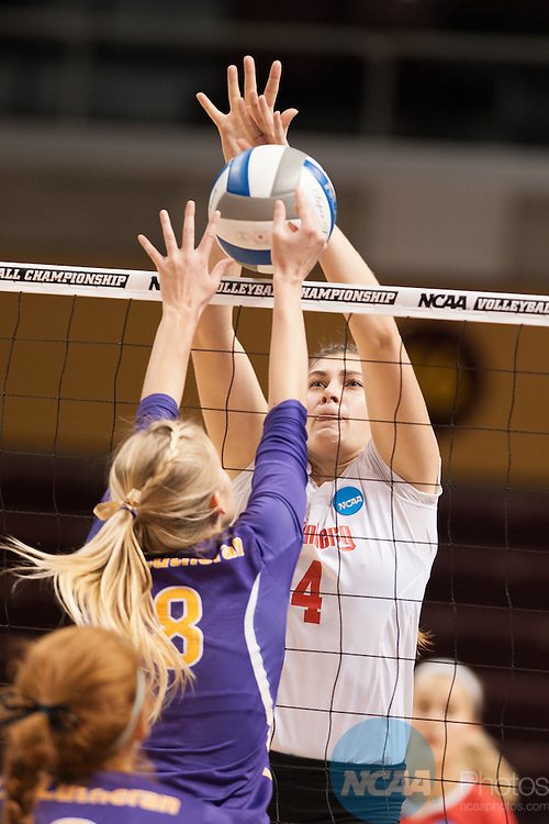 21 NOV 2015: Wittenberg's Melissa Emming blocks the tip attempt of Cal Lutheran's  Jamie Smith during the Division III Women's Volleyball Championship held at Van Noord Arena on the Calvin University campus in Grand Rapids, MI. Cal Lutheran defeated Wittenberg 3-0 for the national title. Erik Holladay/NCAA Photos