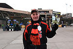 Eugene resident Phil Taggart , an Oregon State graduate sells Oregon programs outside Autzen Stadium for his daughter's school fundraiser..Photo by Jaime Valdez
