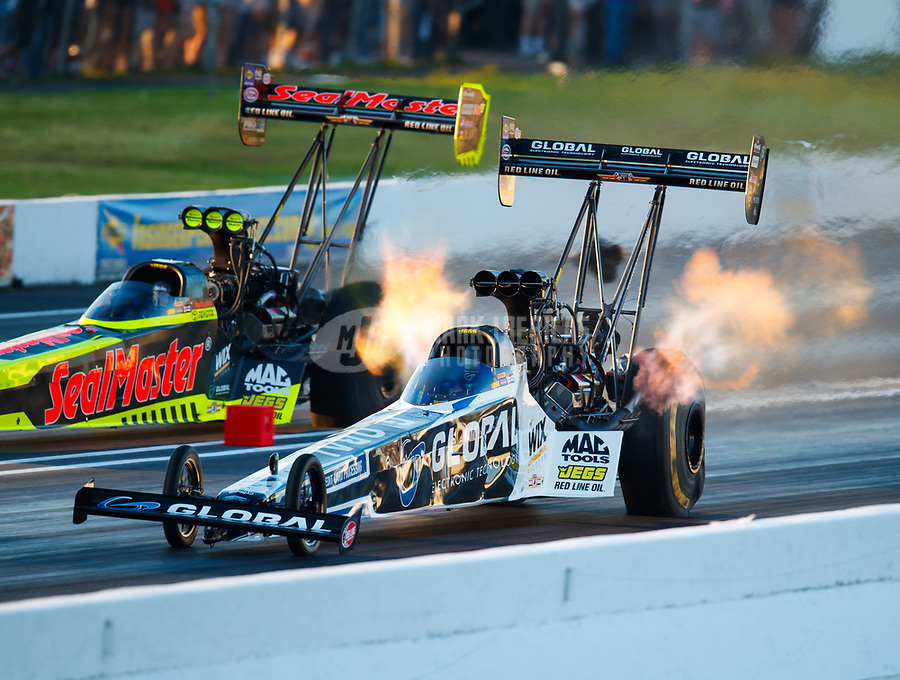 Jun 9, 2017; Englishtown , NJ, USA; NHRA top fuel driver Shawn Langdon (near) alongside Troy Coughlin Jr during qualifying for the Summernationals at Old Bridge Township Raceway Park. Mandatory Credit: Mark J. Rebilas-USA TODAY Sports