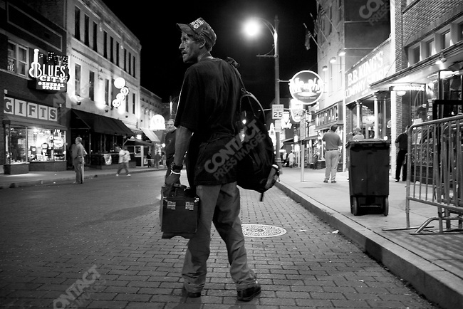 Shoe shine man looking for business along Beale Street, Memphis, Tennessee, USA, September 2007