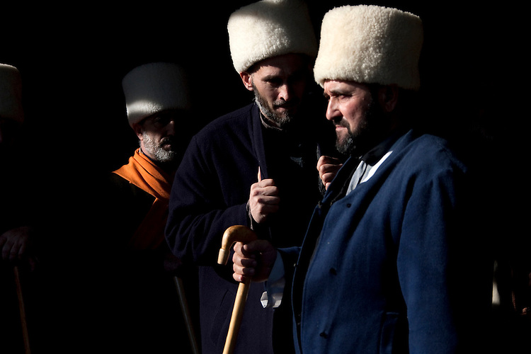 Men belonging to the White Hats Sufi sect is attending Dhikr, a religious ceremony to praise Allah held at the funerals. Novogroznensky, Chechnya, Russia, 2010