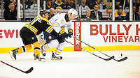 Boston Bruins center Gregory Campbell #11 stretches to knock away the puck from Buffalo Sabres defenseman Tyler Myers #57.  Second period game action from Saturday's Bruins versus Sabers match up at TD Garden...GATEHOUSE NEWS SERVICE PHOTO BY ERIC CANHA