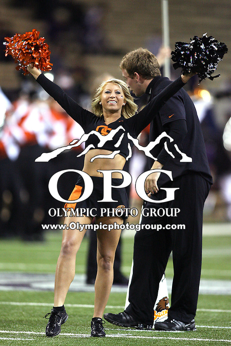 Oct 16, 20010: Oregon State cheerleaders electrified the crowed with their dance moves during pre-game activities.  Washington defeated Oregon State 35-35 in double overtime at Husky Stadium in Seattle, Washington...