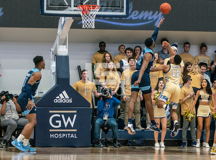 WASHINGTON, DC - FEBRUARY 8: Jameer Nelson Jr. #12 of George Washington lobs a shot over Cyril Langevine #10 of Rhode Island during a game between Rhode Island and George Washington at Charles E Smith Center on February 8, 2020 in Washington, DC.