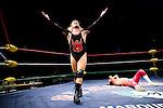 Lucha Libre AAA wrestler Pimpenela exults over a defeated Deccnis at a match in Sacramento, CA March 28, 2009.