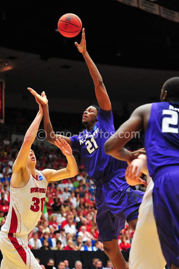 Mar 19, 2011; Tucson, AZ, USA; Kansas State Wildcats center Jordan Henriquez-Roberts (21) shoots the ball over Wisconsin Badgers forward Jon Leuer (30) in the second half of a game in the third round of the 2011 NCAA men's basketball tournament at the McKale Center.  The Badgers won 70-65.