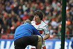 LONDON, ENGLAND - MAY 20: 2011-12 Luton's J. P. Kissock (r) receives treatment during the Blue Square Bet Conference League promotion final between Luton Town FC and York City FC at Wembley Stadium on May 20, 2012 in London, England. (Photo by Dave Horn - Extreme Aperture Photography)