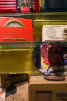 "Vintage radios and music memorabilia are on display in a hallway off the lobby of The Verb Hotel in the Fenway neighborhood of Boston, Massachusetts, USA, on Friday, Dec. 4, 2015. The hotel is considered a ""boutique hotel"" and has collections on display throughout the premises of music memorabilia from the Boston area."