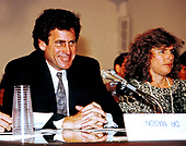 Actor and director Paul Michael Glaser, left, husband of Elizabeth Glaser, right, testifies during a pediatric AIDS hearing before the United States House Budget Committee's Task Force on Human Resources on Capitol Hill in Washington, DC, March 13, 1990. Elizabeth Glaser contracted the AIDS virus after receiving an HIV-contaminated blood transfusion in 1981 while giving birth, subsequently infecting both of her children. One of their children, daughter Ariel, died in 1988 of the disease.  Mrs. Glaser passed away from the disease on December 3, 1994.   <br /> Credit: Howard Sachs / CNP