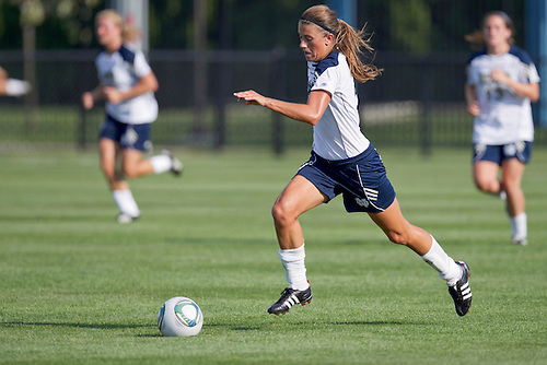 Notre Dame midfielder Mandy Laddish (#2) dribbles the ball upfield in action during NCAA Women's soccer match between Wisconsin and Notre Dame.  The Notre Dame Fighting Irish defeated the Wisconsin Badgers 2-0 in match at Alumni Field in South Bend, Indiana.