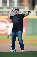 Comedian John Caparulo throws out a ceremonial first pitch prior to the International League game between the Gwinnett Braves and the Charlotte Knights at BB&T BallPark on August 4, 2017 in Charlotte, North Carolina.  The Knights defeated the Braves 7-5 in a game shortened to 8 innings due to rain.  (Brian Westerholt/Four Seam Images)