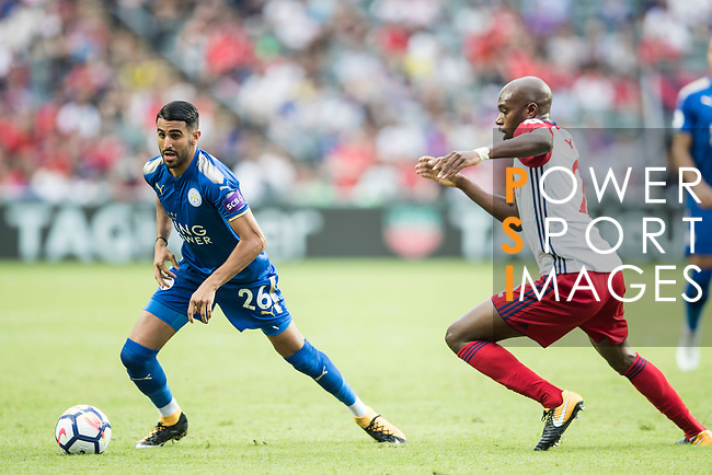 Leicester City FC midfielder Riyad Mahrez (L) fights for the ball with West Bromwich Albion defender Allan Nyom during the Premier League Asia Trophy match between Leicester City FC and West Bromwich Albion at Hong Kong Stadium on 19 July 2017, in Hong Kong, China. Photo by Yu Chun Christopher Wong / Power Sport Images
