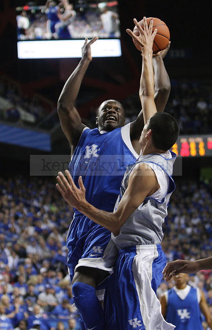 Kentucky Wildcats forward Julius Randle (30) jumps to shoot the ball against Kentucky Wildcats forward Derek Willis (35) during the first half of the Blue-White scrimmage at Rupp Arena in Lexington, Ky., on Tuesday, October 29, 2013. Photo by Tessa Lighty | Staff