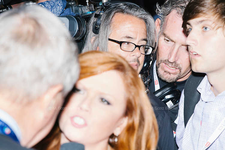 People crowd around as NBC News correspondent Kelly O'Donnell (red hair) interviews a man on the delegate floor on the final day of the Democratic National Convention at the Wells Fargo Center in Philadelphia, Pennsylvania, on Thurs., July 28, 2016.