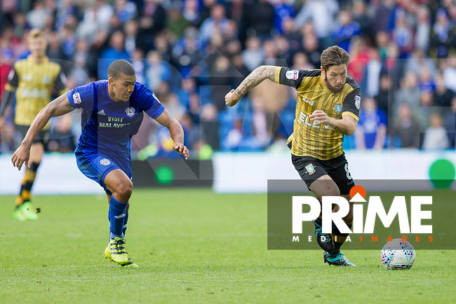 Lee Peltier of Cardiff City and Jacob Butterfield of Sheffield Wednesday during the Sky Bet Championship match between Cardiff City and Sheffield Wednesday at Cardiff City Stadium, Cardiff, Wales on 16 September 2017. Photo by Mark  Hawkins / PRiME Media Images.