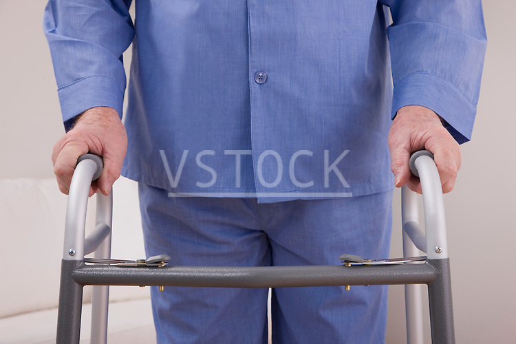 Senior man with on walker, mid section