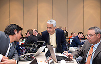 US Soccer president Sunil Gulati talks to Brian Ching and Tony DiCicco of the Houston Dash during the NWSL draft at the Pennsylvania Convention Center in Philadelphia, PA, on January 17, 2014.