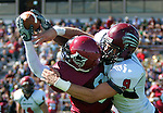 Brian Myrick / Daily Record..CWU's Sam Togar (8) grabs a pass despite the best efforts of Cougar's Shea Struiksma (9) to break it up as the Wildcats take on Azusa Pacific in first quarter action at Tomlinson Stadium, Saturday, Sept. 19, 2009.