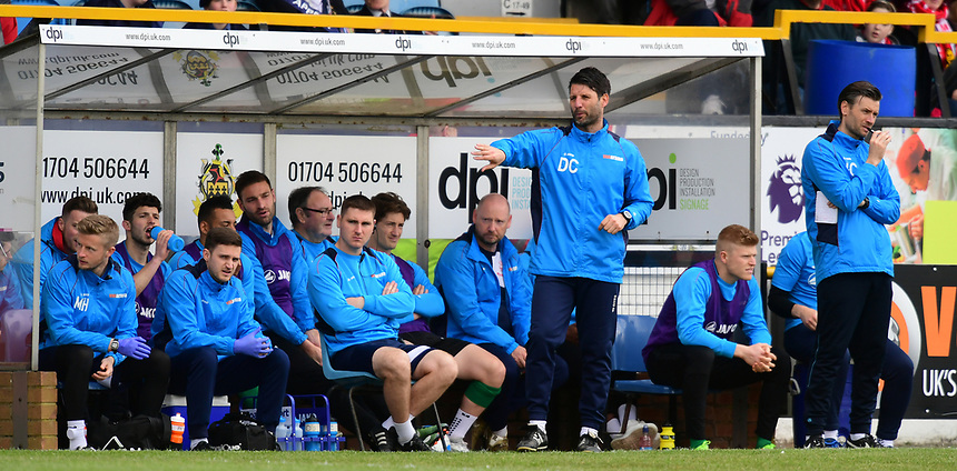 Lincoln City manager Danny Cowley, stood left, shouts instructions to his team from the dug-out<br /> <br /> Photographer Chris Vaughan/CameraSport<br /> <br /> Vanarama National League - Southport v Lincoln City - Saturday 29th April 2017 - Merseyrail Community Stadium - Southport<br /> <br /> World Copyright &copy; 2017 CameraSport. All rights reserved. 43 Linden Ave. Countesthorpe. Leicester. England. LE8 5PG - Tel: +44 (0) 116 277 4147 - admin@camerasport.com - www.camerasport.com