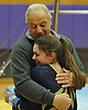 Massapequa coach Mike Capone gives Gillian Murphy a congratulatory hug after she scored an 8.5 on the uneven bars in a Nassau County varsity gymnastics meet against Plainview JFK at McKenna Elementary School on Monday, Feb. 1, 2016.