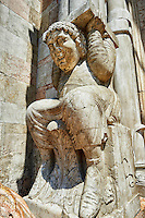 Atlas  holding up a column that supports the canopy above the main portal of the 12th century Romanesque Ferrara Duomo, Italy