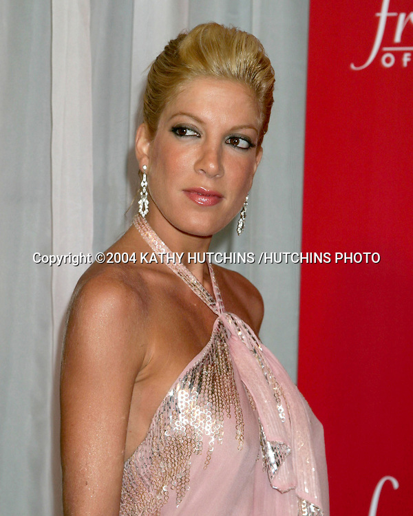 ©2004 KATHY HUTCHINS /HUTCHINS PHOTO.FREDERICKS OF HOLLYWOOD LINGERIE ART AUCTION.HOLLYWOOD, CA.OCTOBER 20, 2004..TORI SPELLING