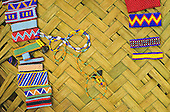 Xingu, Brazil. Colourful bead bracelets made by Kayapo women for the Body Shop on a woven palm mat; A-Ukre village.
