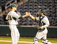 Pitcher Jeff Kinley (28) of the Michigan State Spartans is congratulated by catcher John Martinez (3) after closing out a game against the Furman Paladins on February 25, 2012, at Fluor Field in Greenville, South Carolina. (Tom Priddy/Four Seam Images)