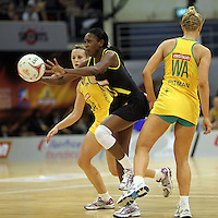09.07.2011 Jamaica's Kameika Sherwood in action during the netball match between Jamaica and Australia at the Mission Foods World Netball Championship 2011 held at the Singapore Indoor Stadium in Singapore . Mandatory Photo Credit ©Michael Bradley.