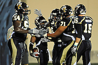 11 September 2010:  FIU offensive linesman Rupert Bryan Jr. (54), wide receiver T.Y. Hilton (4), offensive linesman Caylin Hauptmann (71), and tight end Colt Anderson (15) celebrate with running back Jeremiah Harden (6) after he scored a touchdown in the third quarter as the Rutgers Scarlet Knights defeated the FIU Golden Panthers, 19-14, at FIU Stadium in Miami, Florida.
