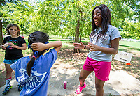 From left, Sasha Harvey, 10, and Katie Chung, 9, listen as student camp counselor Demi Wilkins, a junior elementary education major from Aliceville, Alabama, explains a team-building activity outside the Sanderson Center. The &quot;Adventure Race&quot; is part of this week's Youth Dawgs Summer Recreation Camp sponsored by MSU Recreation. Campers age 5-12 learn how to make healthy lifestyle choices about exercise and proper nutrition. They also gain self-confidence while participating in team-building events, noncompetitive team sports and other physical fitness activities.<br />