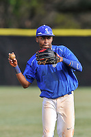 Center fielder Dominique Jackson (16) of the Spartanburg Methodist College Pioneers warms up before a junior college game against Surry Community College on January 31, 2016, at Mooneyham Field in Spartanburg, South Carolina. (Tom Priddy/Four Seam Images)