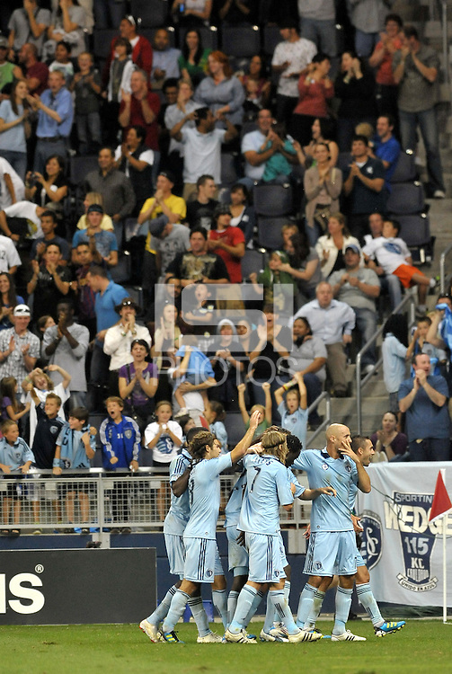 Sporting KC players celebrate their go ahead goal... Sporting Kansas City defeat Columbus Crew 2-1 at LIVESTRONG Sporting Park, Kansas City, Kansas.